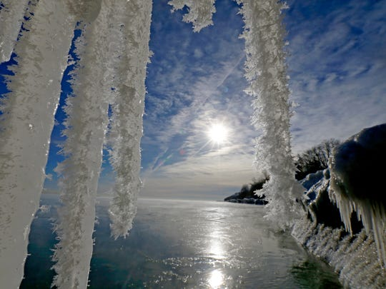 Icicles hang from a chunk of ice off the shore of Lake Michigan at Big Bay Park on N. Lake Drive in Whitefish Bay.