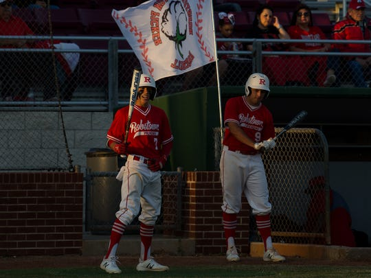 Robstown players wait on deck against Sinton last week. The Cotton Pickers are 4-0 in District 31-4A play.