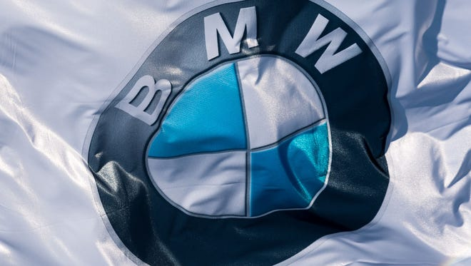 (FILES) This file photo taken on May 11, 2017 shows a flag with the BMW logo is pictured prior to the annual general meeting in Munich.