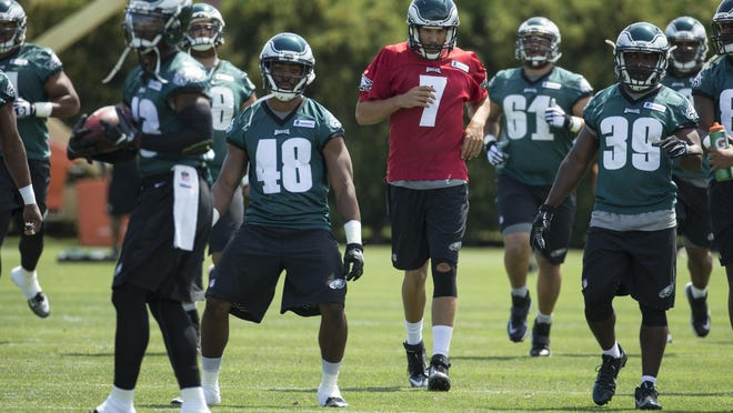 Philadelphia Eagles quarterback Sam Bradford (7) warms up with his teammates during practice at NFL football training camp, Sunday, Aug. 2, 2015, in Philadelphia. (AP Photo/Chris Szagola)