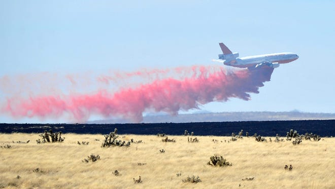 A DC-10 drops a load of retardant along the western edge of the Viewpoint Fire that started along Highway 89A in Prescott Valley on May 11, 2018 in Prescott Valley. The fire, driven by a sustained wind, headed north into the Poquito Valley area.