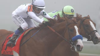 BALTIMORE, MD - MAY 19: Justify #7 ridden by jockey Mike Smith leads the field before winning the 143rd running of the Preakness Stakes at Pimlico Race Course on May 19, 2018 in Baltimore, Maryland. (Photo by Todd Olszewski/Getty Images)