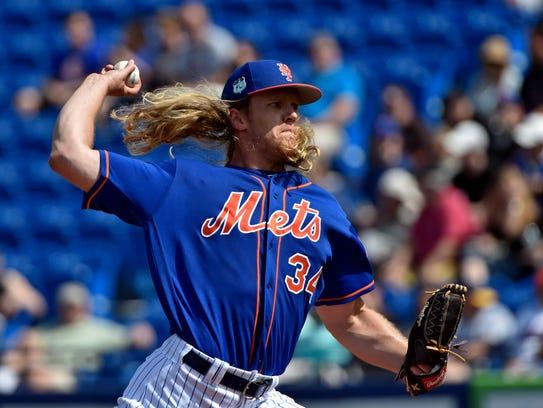 Mets starting pitcher Noah Syndergaard (34) throws