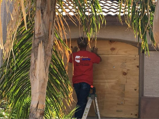 Phoenix police hired Arizona Fire & Water Restoration Inc. to board up the windows and doors of the home where the shooting took place.