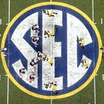 The SEC's head football coaches draw an average salary of $4 million.