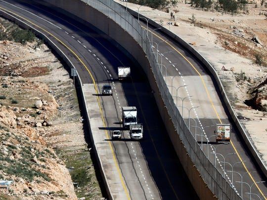 PALESTINIAN-ISRAEL-CONFLICT-ROAD