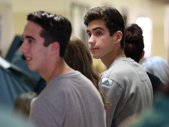 Brady Henderson waits in line as he prepares to vote in the 2016 election with his brother Cormac and sister Abarrane on their birthday Tuesday, Nov. 1, 2016, at London High School in Corpus Christi.