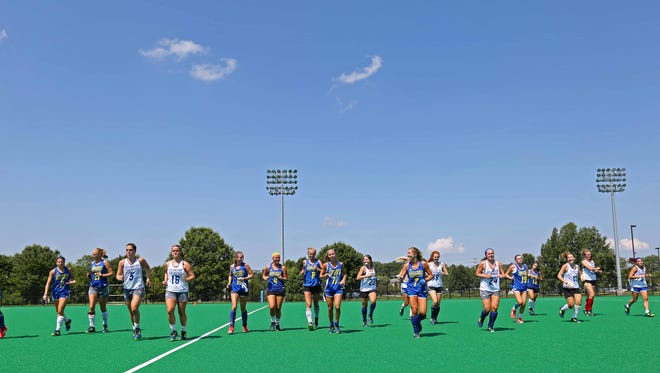The University of Delaware field hockey team cools down after a short sprint across the field at Rullo Stadium on their first practice day coming off a 2016 NCAA championship.