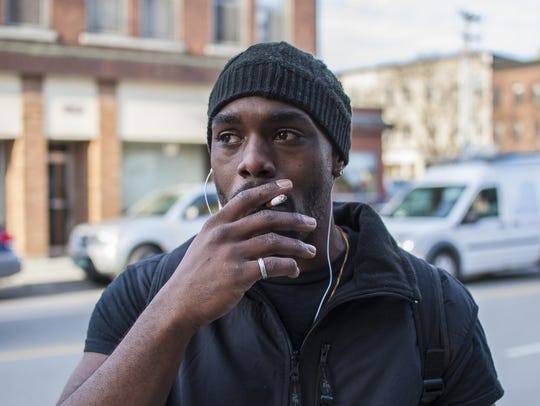 Roi Erno, 29, of Burlington, smokes in Burlington on