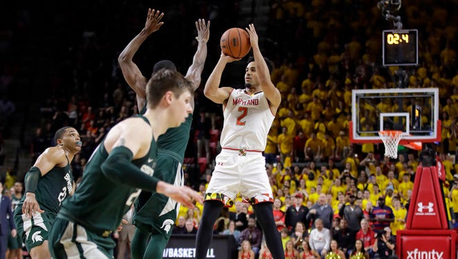 Maryland guard Melo Trimble (2) shoots the game-winning shot in the final moments of an NCAA college basketball game against Michigan State, Saturday, March 4, 2017, in College Park, Md. Maryland won 63-60. (AP Photo/Patrick Semansky)