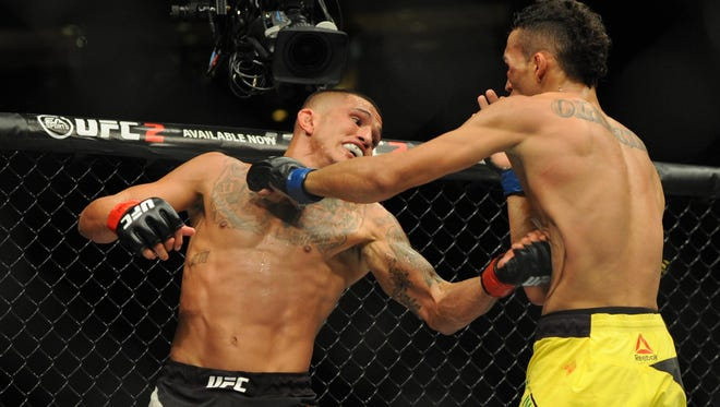Anthony Pettis (red gloves) competes against Charles Oliveria (blue gloves) during UFC Fight Night at Rogers Arena in August.