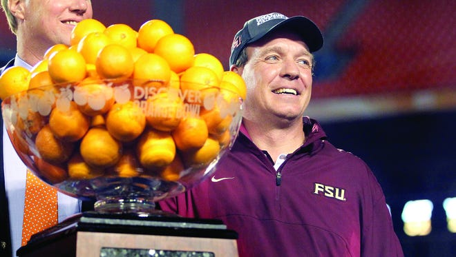 Jimbo Fisher accepting the trophy after FSU won the 2013 Orange Bowl.