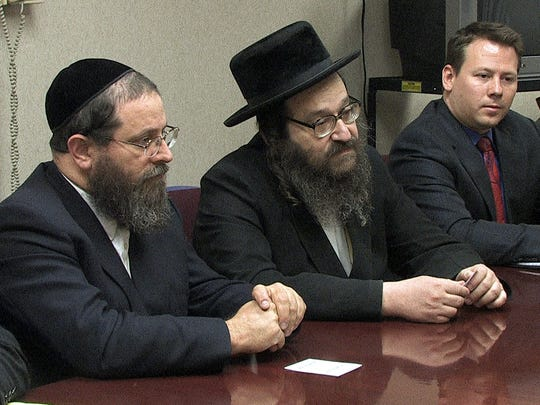 From left, Michael Tauber, Rabbi Mordecai Babad and Roman Storzer speak at the Journal News in West Nyack May 8, 2007 about their plan to build the Rabinical College of Tartikov in Pomona. ( Peter Carr / The Journal News )