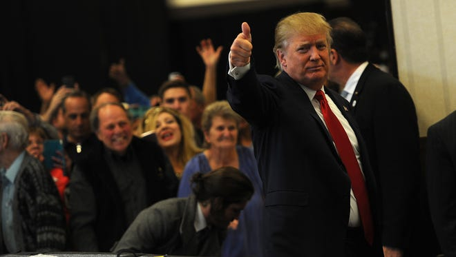 Republican presidential candidate Donald Trump greets his supporters before speaking during a campaign rally at the Nugget Hotel and Casino in Sparks on Oct. 29, 2015.