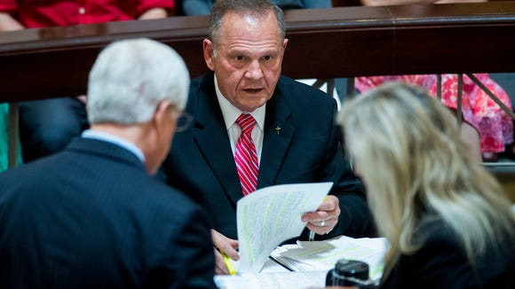 Roy Moore prepares for his hearing before the Court of the Judiciary at the state judicial building in Montgomery, Ala., on Monday August 8, 2016.
