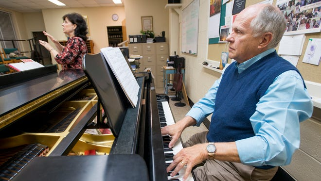 Composer Allen Pote plays the piano during choir rehearsal Nov. 15, 2017, at the First Presbyterian Church in Pensacola.