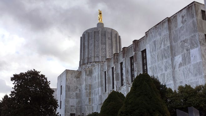 Clouds hover over the Capitol in Salem, Ore., Thursday, Jan. 11, 2018. The intense national focus on sexual misconduct came to Oregon's capital this week, when lawmakers were given a training session on harassment and how to report it.