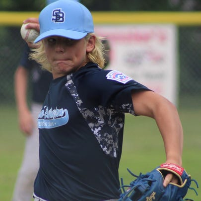 Keifer McGrath delivers a pitch during Saturday's 11-12-year-old