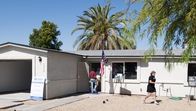 Habitat for Humanity Central Arizona dedicated a house for a family. The house is one of several the non-profit has built or remodeled in Chandler in the past year.