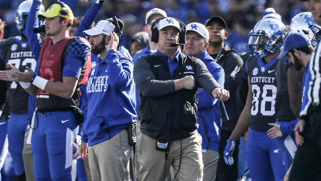 Kentucky coach Mark Stoops walks the sidelines in the first half.November 25 2017