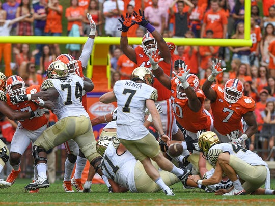 Clemson defensive lineman Christian Wilkins (42), defensive lineman Dexter Lawrence (90), and defensive lineman Austin Bryant (7) try to block a field goal attempt by Wake Forest kicker Mike Weaver (7) during the 3rd quarter on Saturday, October 7, 2017 at Clemson's Memorial Stadium.