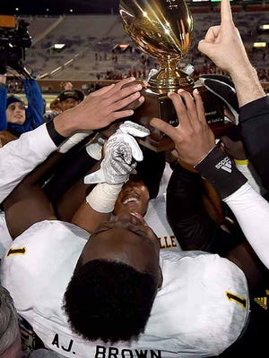 Dandy Dozen Starkville wide receiver A.J. Brown celebrates the Yellowjackets Class 6A state championship.