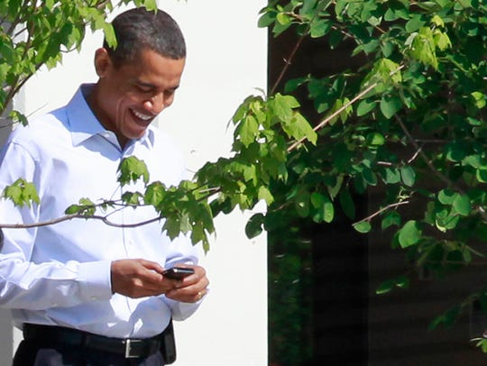 President Obama uses his BlackBerry phone.
