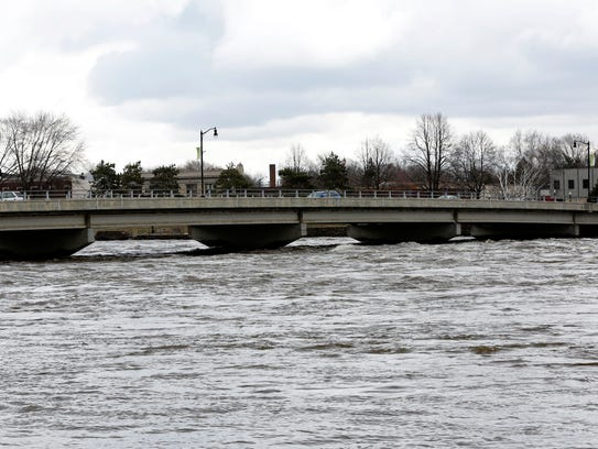 Water from the Wisconsin River rushes up to the foot