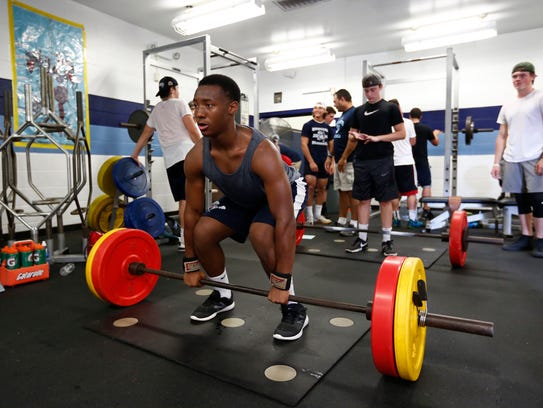 John Jay football players hit the weight room prior