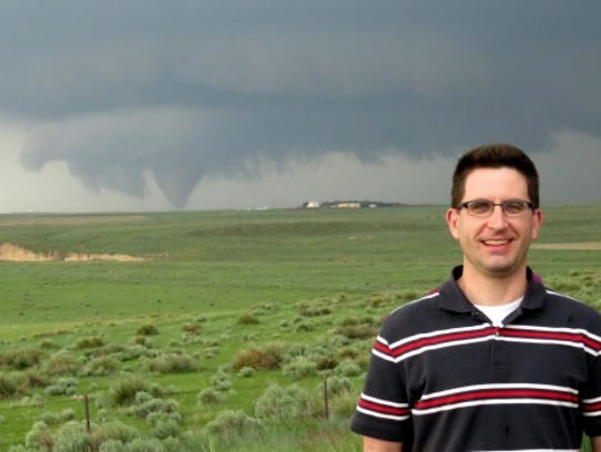 David Call poses for a photo during one of his storm-chasing