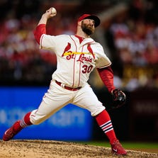 Sep 20, 2014; St. Louis, MO, USA; St. Louis Cardinals relief pitcher Jason Motte (30) throws to a Cincinnati Reds batter during the fifth inning at Busch Stadium. The Cardinals defeated the Reds 8-4.