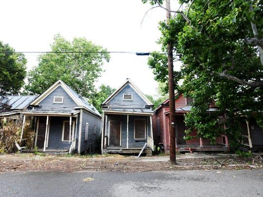 Abandoned shot-gun homes in Ledbetter Heights.