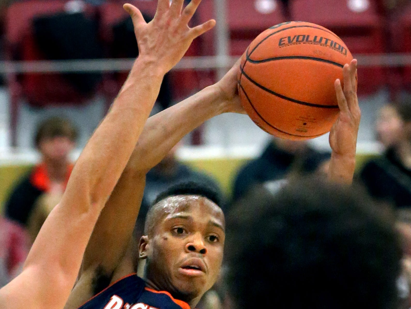 Blackman's Isaiah Hart looks for an open player as he is surrounded by Riverdale players in the first half of the game at Riverdale on Friday Jan. 9, 2015.