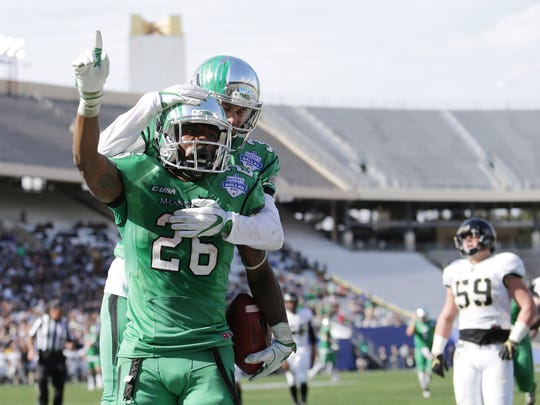 North Texas Mean Green running back Jeffrey Wilson (26) celebrates after scoring a touchdown against Army Black Knights in the first half in the Heart of Dallas Bowl at Cotton Bowl Stadium.