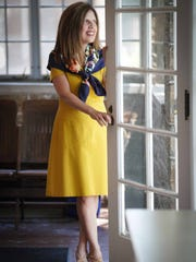 Denise Nordheimer wears a mustard-colored Boden dress; Hermes print scarf; and camel suede L'amour des pieds pumps from Benjamin Lovell Shoes.