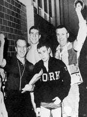 The William Penn swim team celebrates a District 3 team swimming championship. From left to right: head coach Donald Houseal, swimmer Bill Groft, swimmer Bob Ruth and assistant coach Bill Schmidt. Two of the best swimmers in William Penn's history appear in the photo. Bill Groft won six state gold medals and swam at Michigan, and Schmidt won five state gold medals and competed in the U.S. Olympic Trials. This picture originally appeared in the William Penn yearbook, The Tattler.