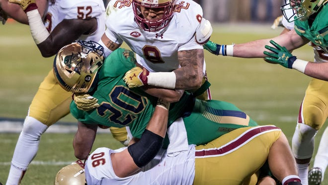 B.C.'s Harold Landry, top, tackles Notre Dame's C.J. Prosise at Fenway Park on Nov. 21, 2015.