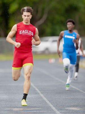 Pine Forest High School's Marcus Reaves pulls away from his competition during the preliminary round of the 200-meter dash during the District 1 3-A track meet at Washington High School Wednesday afternoon.