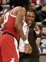 Alabama coach Avery Johnson, right, points toward the