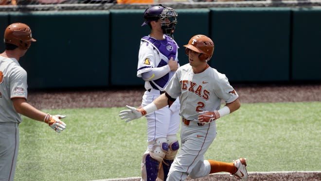 Texas' Kody Clemens (2) crosses the plate after hitting a home run against Tennessee Tech in the third inning Sunday.