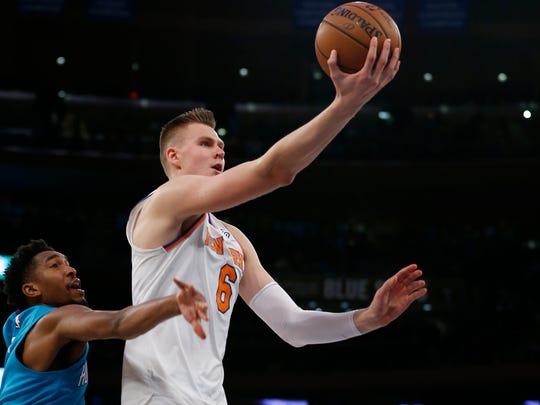 New York, NY, USA; New York Knicks forward Kristaps Porzingis (6) drives to the basket against Charlotte Hornets guard Malik Monk (1) during second half at Madison Square Garden.