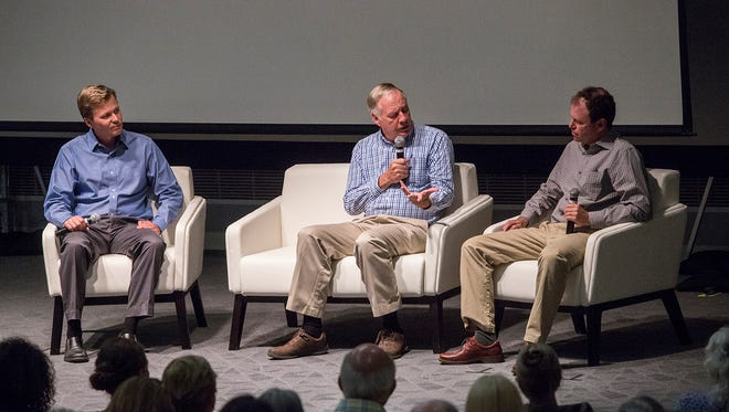 From left, Desert Sun reporter Ian James converses about the Salton Sea with UC Irvine Professor Tim Bradley and Biologist Dan Cooper during a public event held at the University of California Riverside Palm Desert Center on June 20, 2017.