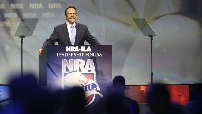 Alton Strupp/The Courier-Journal Gov. Matt Bevin speaks Friday during the 145th NRA Convention. About 800 exhibitors there sold an array shooting goods and services. Kentucky Gov. Matt Bevin speaks during the 145th NRA Convention inside Freedom Hall on Friday afternoon. May 20, 2016