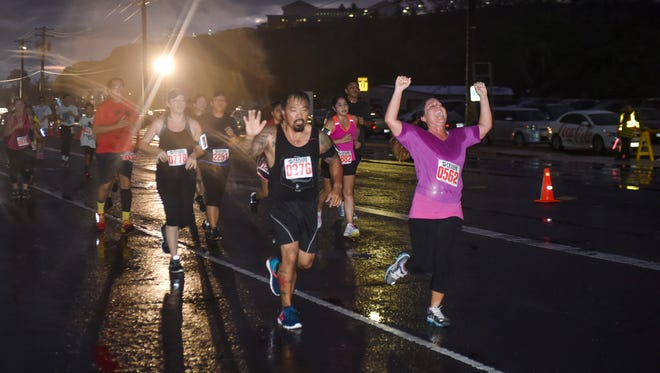 Celebrations were made as runners approached the finish line during the Payless Supermarkets 2016 Kick the Fat 20th Annual 5k/10K in Adelup on March 19.