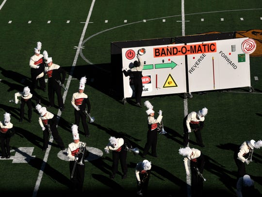 Members of the Eastland High School Maverick Band pantomime