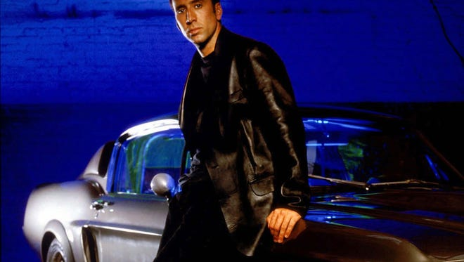 """Nicolas Cage with the 1967 Mustang Shelby GT500 used in the film """"Gone in Sixty Seconds."""""""