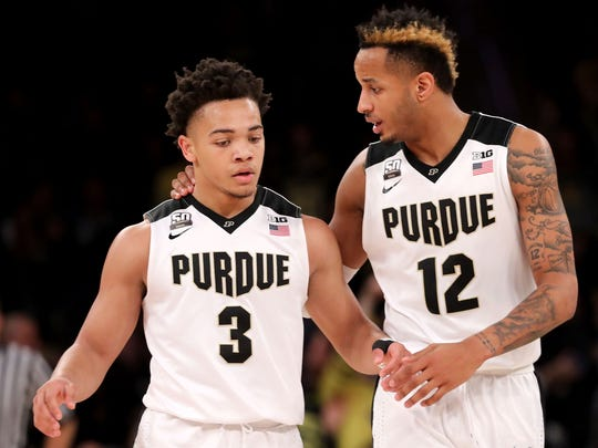 Carsen Edwards, left, and Vincent Edwards chat during the Big Ten tournament earlier this month in New York.