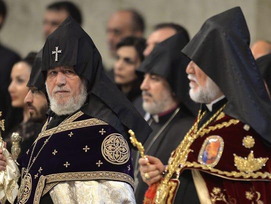 Armenian church leader Karekin II, left, attends a