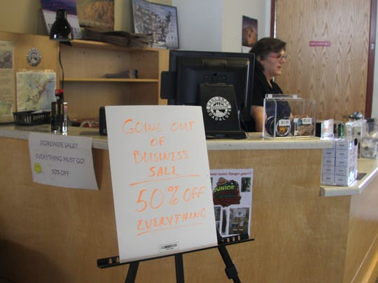 Employee Dorry Batchelder stood behind the register on the bookstore's last day in business on Feb. 17.