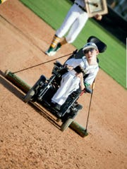 Shae Stelly's job during field preparation was to drag the field while on his wheelchair.